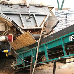 A truck delivers bark materials to Miller LC. It uses fine ground bark to add carbon in compost and soil-conditioners.