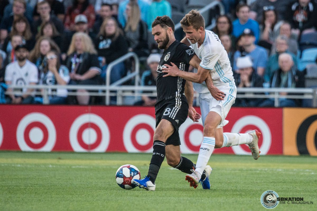 Zusi tries to hold off Colin Martin during Minnesota United's 4-1 win over Sporting Kansas City in the US Open Cup