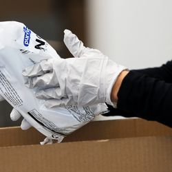 Tamara Bell packs N95masks at Zagg headquarters in Midvale on Tuesday, April 14, 2020.The company is donating 10,000 of the masks to hospitals, medical professionals and high-risk individuals to help combat the spread of COVID-19 in the communities in which the company operates.