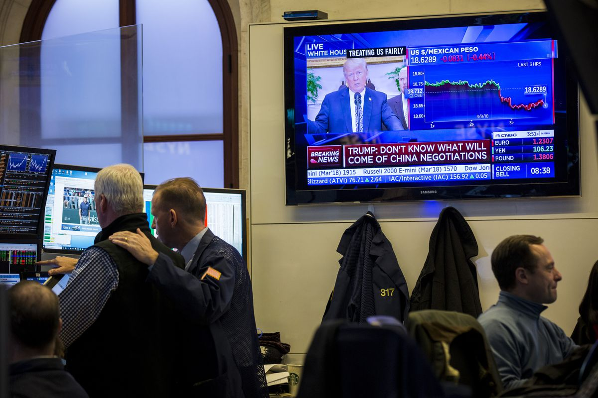 President Donald Trump is displayed on a television monitor as a trader works on the floor of the New York Stock Exchange ahead of the closing bell, March 8, 2018, in New York City.