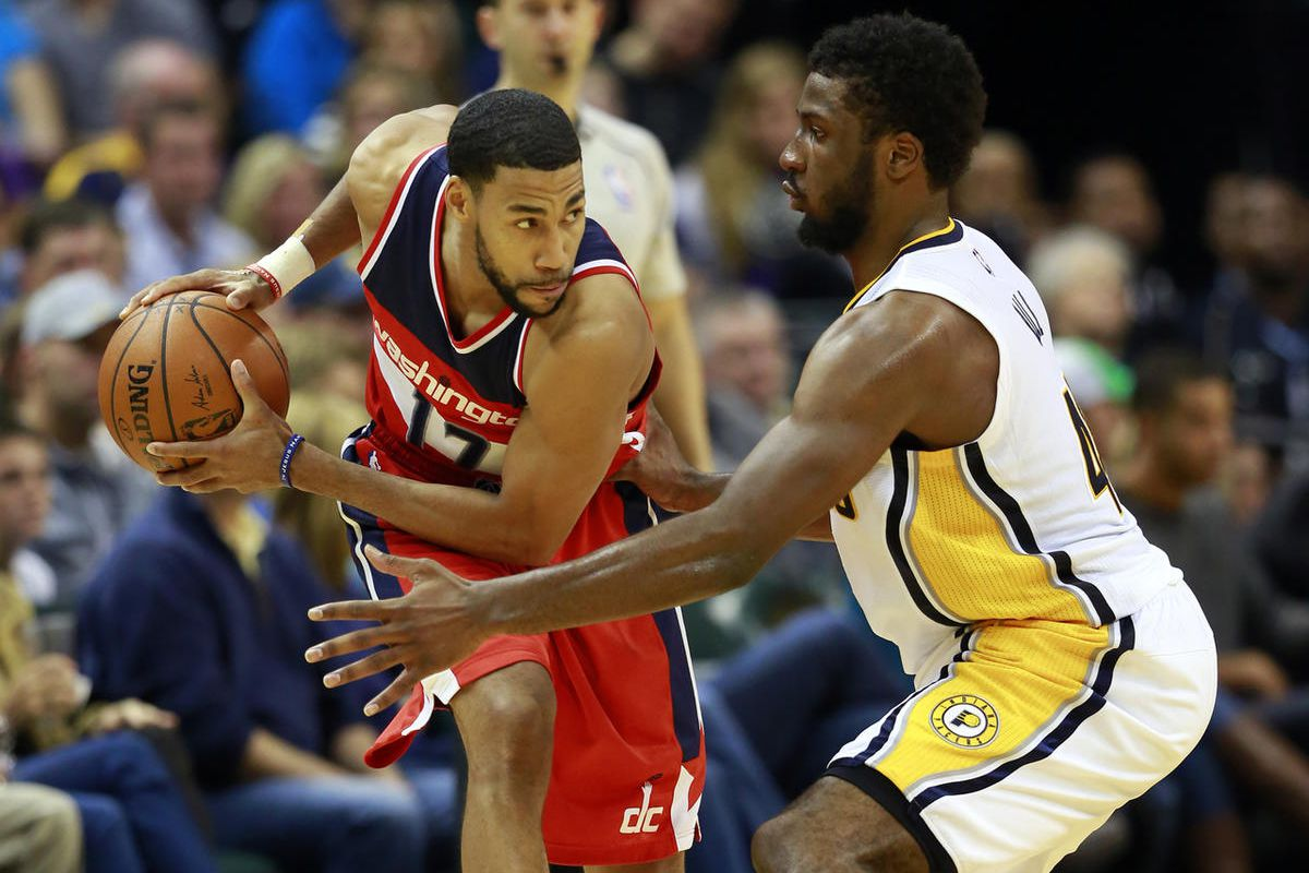 Washington Wizards guard Garrett Temple, left, keeps the basketball from Indiana Pacers forward Solomon Hill during the second half of an NBA basketball game in Indianapolis, Saturday, Nov. 8, 2014. Washington won 97-90.