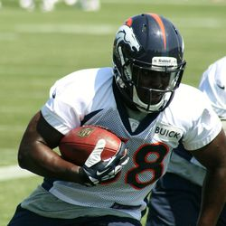 Denver Broncos rookie running back Montee Ball carries during drills on the second day of training camp