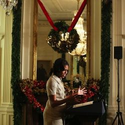 In a <b>Michael Kors</b> suit at the White House holiday decoration preview on November 28, 2012