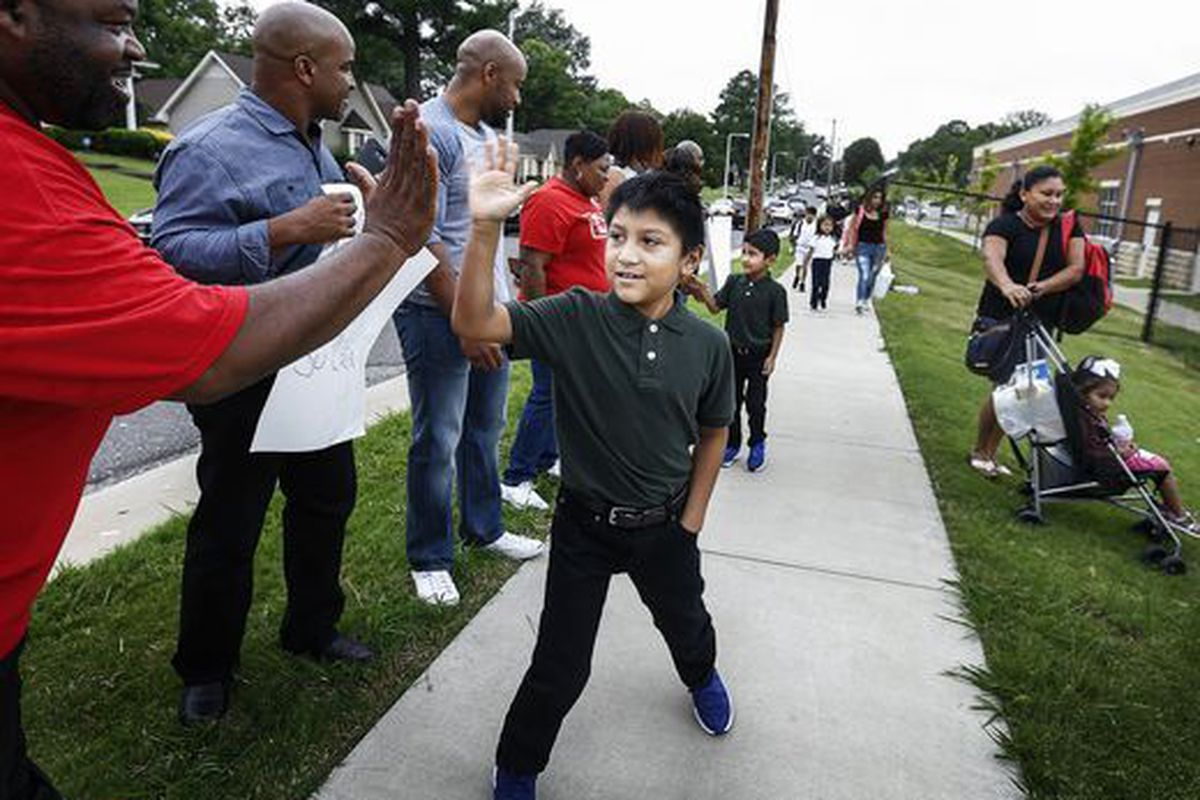 Third-grader Juan de la Cruz is welcomed back to class on Aug. 7 at Belle Forest Community School in Memphis. The back-to-school reception was organized by a neighborhood church as a show of support for students as the city's Hispanic community dealt with recent immigration arrests.