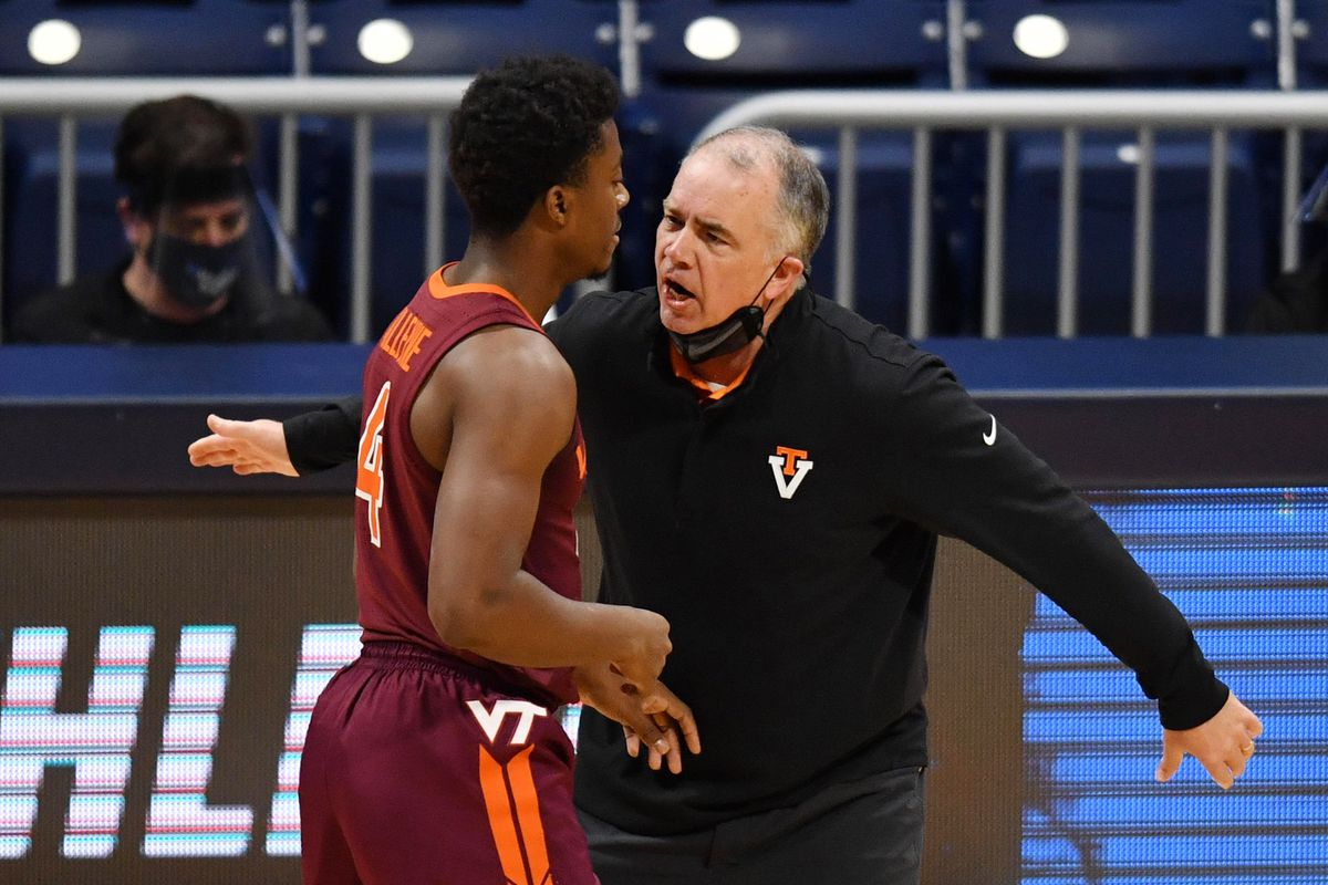 Virginia Tech Hokies head coach Mike Young talks with guard Nahiem Alleyne (4) against the Florida Gators during the first round of the 2021 NCAA Tournament at Hinkle Fieldhouse.