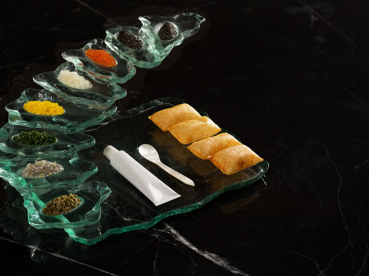 A dramatic caviar flight on a black background