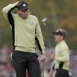 Europe's Sergio Garcia, left, reacts after teammate Luke Donald misses a putt on the fifth hole during a foresomes match at the Ryder Cup PGA golf tournament Friday, Sept. 28, 2012, at the Medinah Country Club in Medinah, Ill.