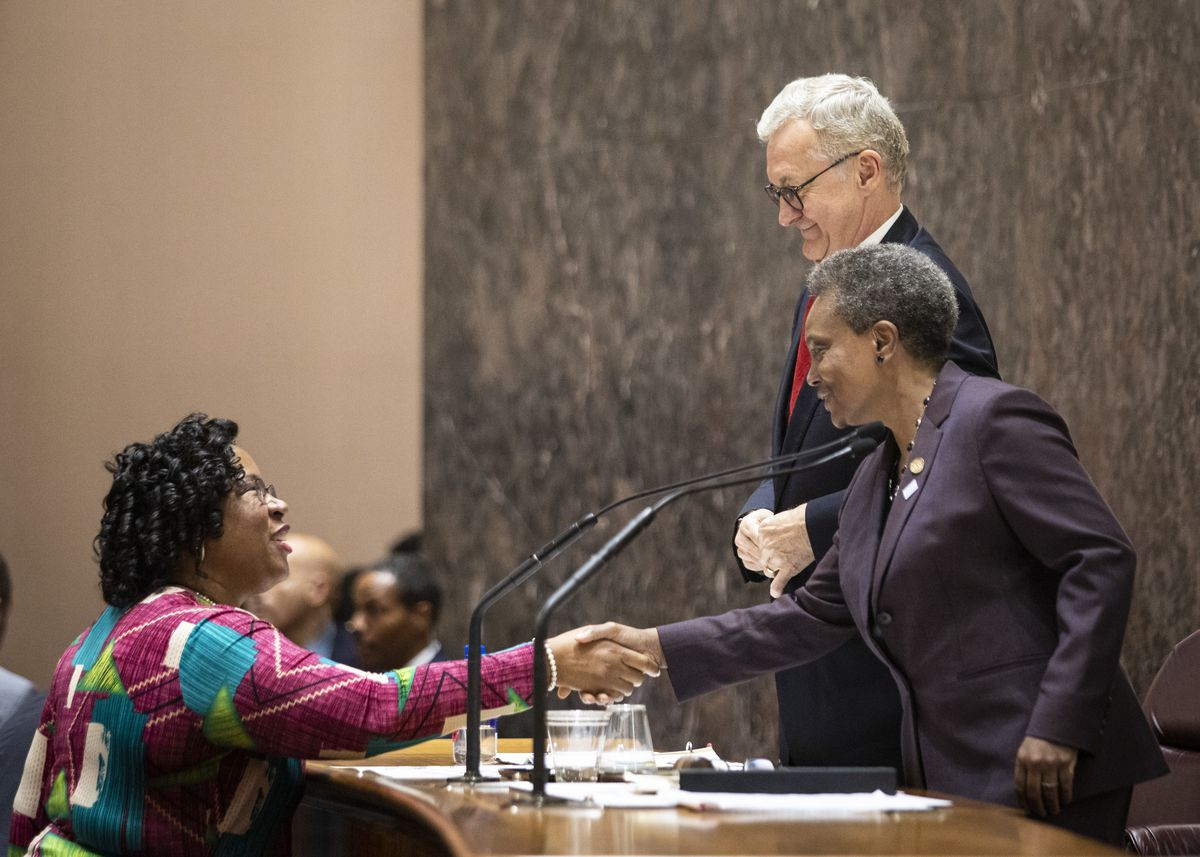 Chicago City Treasurer Melissa Conyears-Ervin shakes hands with Mayor Lori Lightfoot following adjournment of their first Chicago City Council meeting.