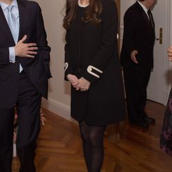 For lunch at the British Consul General's residence in New York City on December 8th, 2014, Kate wears a black crepe coat by Goat.