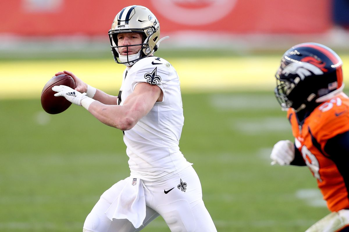 Taysom Hill #7 of the New Orleans Saints looks to pass during the second quarter of a game against the Denver Broncos at Empower Field At Mile High on November 29, 2020 in Denver,