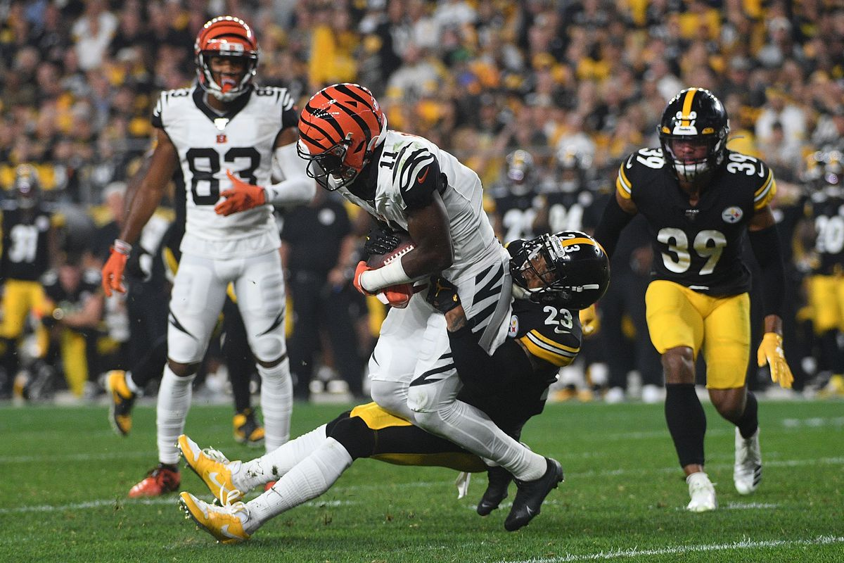 John Ross of the Cincinnati Bengals is wrapped up for a tackle by Joe Haden of the Pittsburgh Steelers in the second half during the game at Heinz Field on September 30, 2019 in Pittsburgh, Pennsylvania.