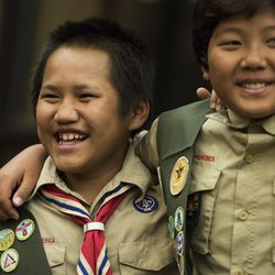 Ta Eh Dee, left, of Troop 1262, laughs with Georgie Kyi after being recognized for his achievements during a Court of Honor ceremony at Camp Tracy Lodge in Salt Lake City on Thursday, Sept. 28, 2016. Troop 1262 makes up one of the six refugee troops in Utah's Boy Scouts of America organization.