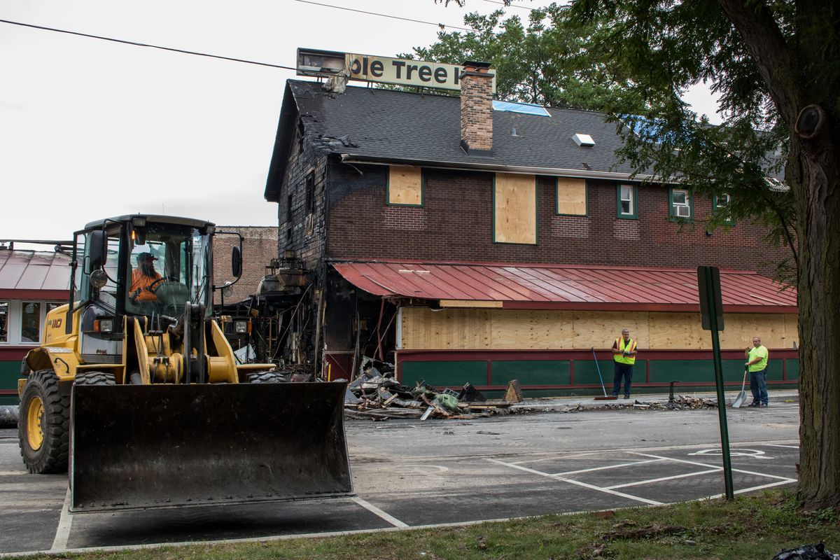 A man operates a front loader with helping clean the debris from Maple Tree Inn. | Manny Ramos/Sun-Times