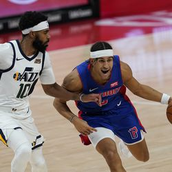 Detroit Pistons guard Frank Jackson drives on Utah Jazz guard Mike Conley (10) during the second half of an NBA basketball game, Sunday, Jan. 10, 2021, in Detroit.