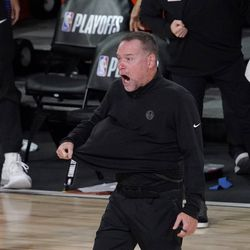 Denver Nuggets head coach Michael Malone walks onto the court during a time out in the second half an NBA first round playoff basketball game against the Utah Jazz on Tuesday, Sept. 1, 2020, in Lake Buena Vista, Fla.