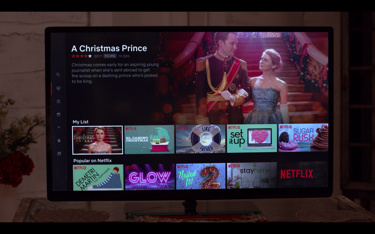A TV showing a Netflix screen with 'A Christmas Prince' selected within 'The Princess Switch'