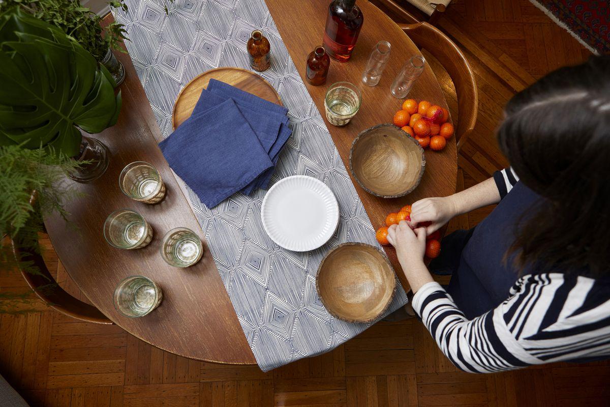 The host preparing the table for dinner.