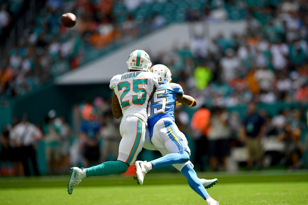 Xavien Howard of the Miami Dolphins attempts to break up the pass to Dontrelle Inman of the Los Angeles Chargers in the second quarter at Hard Rock Stadium on September 29, 2019 in Miami, Florida.