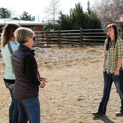 Abby Petchinsky, 21, of Mt. Pleasant, right, talks with Brittani Frade, CMHCi, left, and Jolene Green, LCSW, second from left, at The Barn in South Jordan on Friday, March 17, 2017.