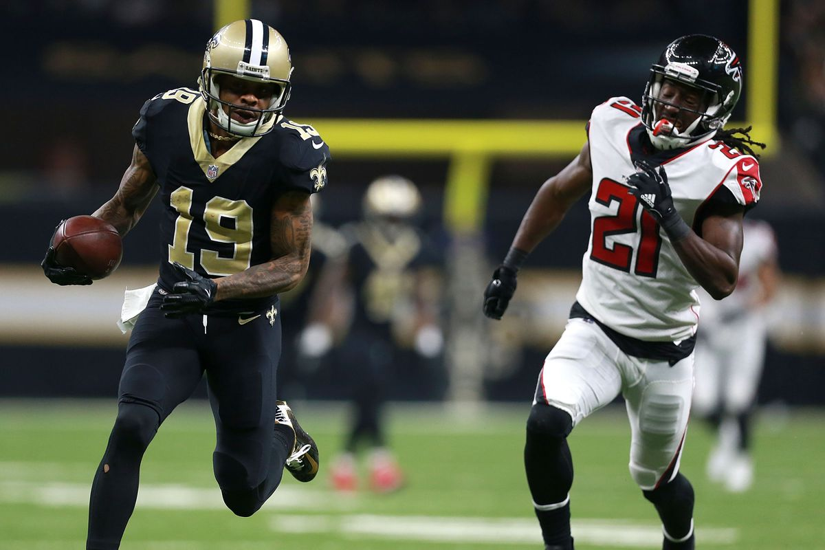 NEW ORLEANS, LA:  New Orleans Saints wide receiver Ted Ginn Jr (19) outraces Atlanta Falcons defensive back Desmond Trufant (21) to score a touchdown during a game at the Mercedes-Benz Superdome.