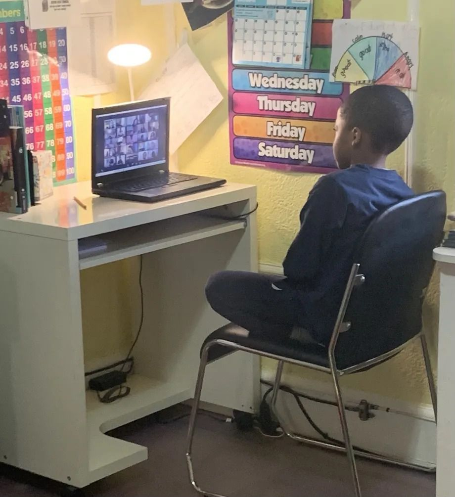 Melinda Edward's son Dillon works during a remote class at home