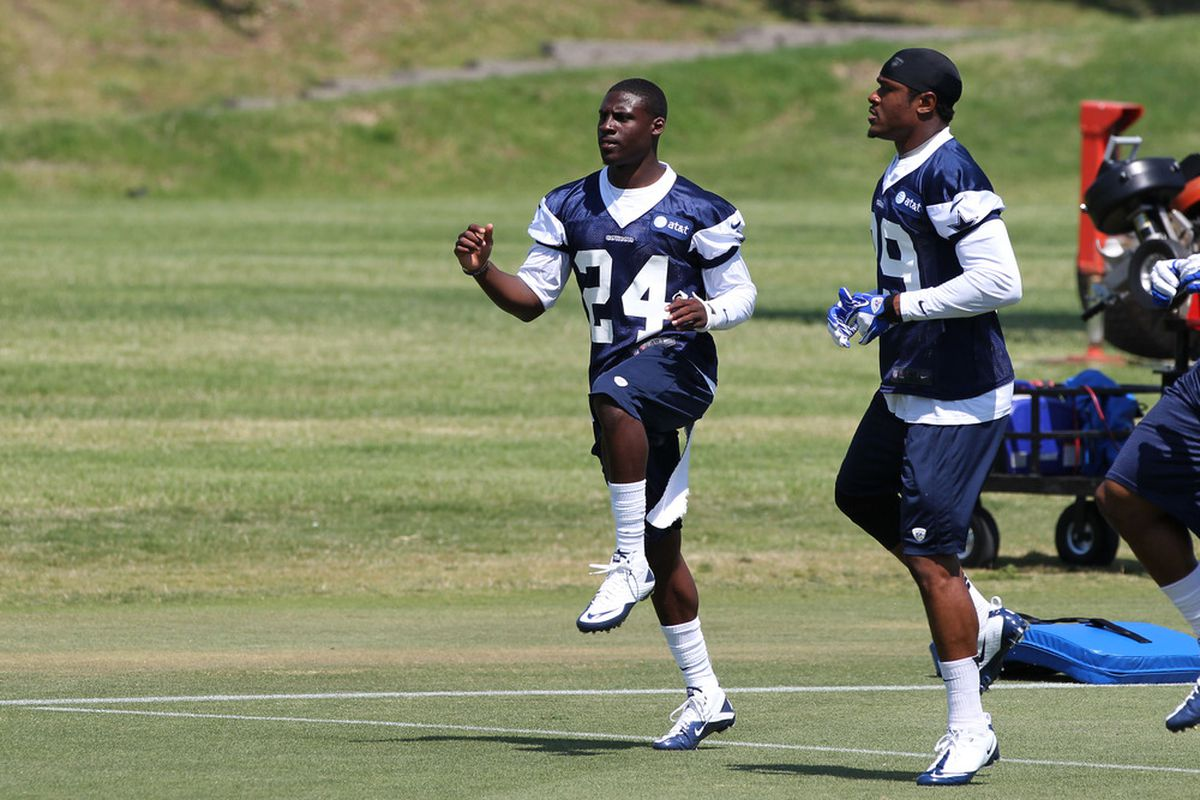 Morris Claiborne (24) and Brandon Carr (39) add extra height to the Cowboys secondary this year.