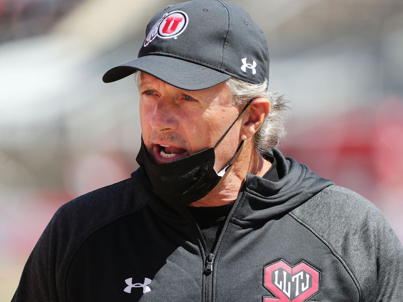 Utah Utes head coach Kyle Whittingham talks to players during the Red and White game in Salt Lake City on Saturday, April 17, 2021.