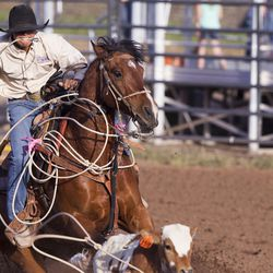 Wyatt Christensen ropes a calf during the Utah High School Rodeo Finals in Heber City on Saturday, June 3, 2017.