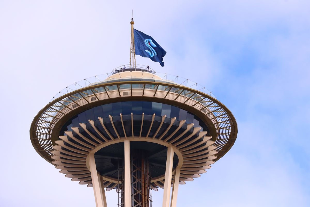 A general view of the Space Needle as the Seattle Kraken team flag is hung from above on July 23, 2020 in Seattle, Washington.