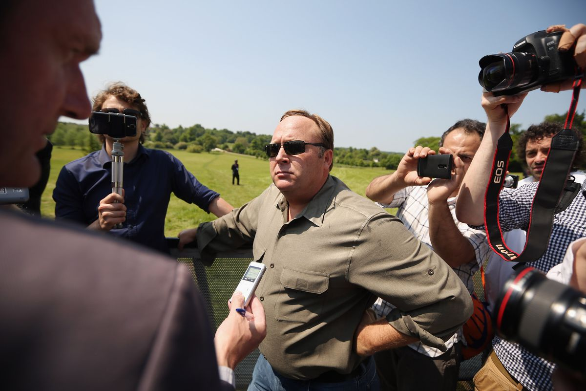 Alex Jones surrounded by cameras and reporters