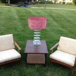 """From Kennett Square's <a href=""""http://www.scoutandannie.com/"""">Scout and Annie</a>: 1963 Paul McCobbtable, $195;lucitelamp with fiberglass shade, $150; '60s reupholstered lounge chairs, $595"""