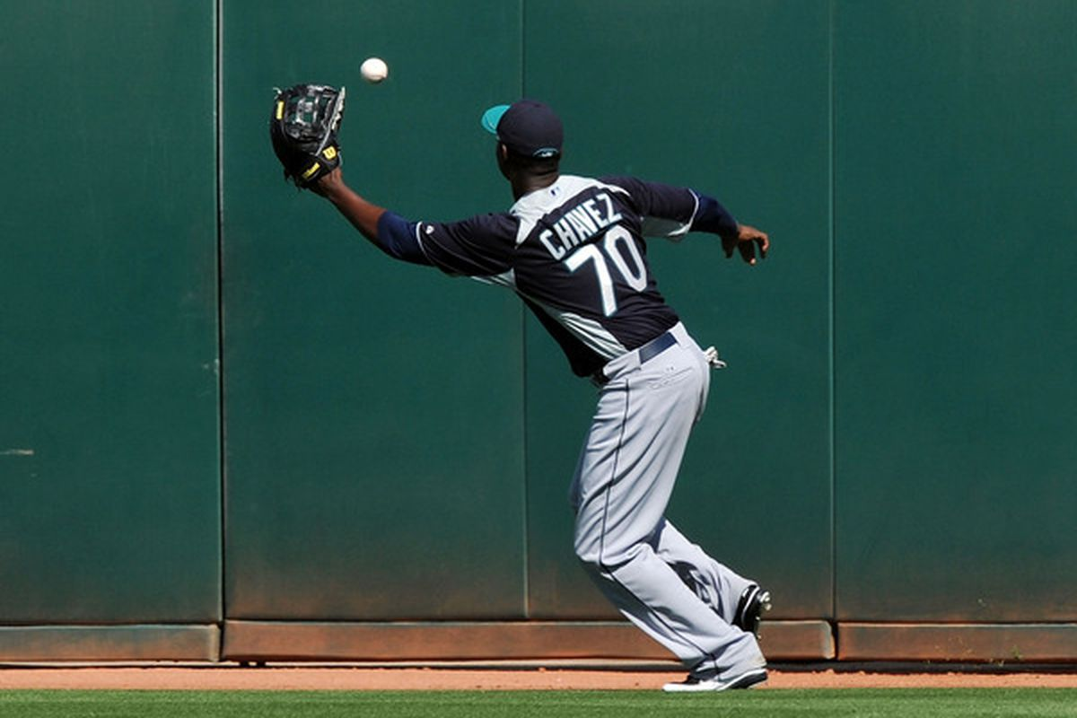 GOODYEAR, AZ - MARCH 11:  Johermyn Chavez #70 of the Seattle Mariners plays the ball off the wall against the Cleveland Indians at Goodyear Ballpark on March 11, 2011 in Goodyear, Arizona.  (Photo by Norm Hall/Getty Images)