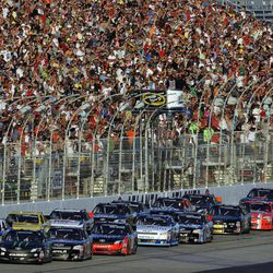 Kyle Busch (54) leads the field at the start of the NASCAR Nationwide Series auto race at Atlanta Motor Speedway, Saturday, Sept. 1, 2012, in Hampton, Ga.