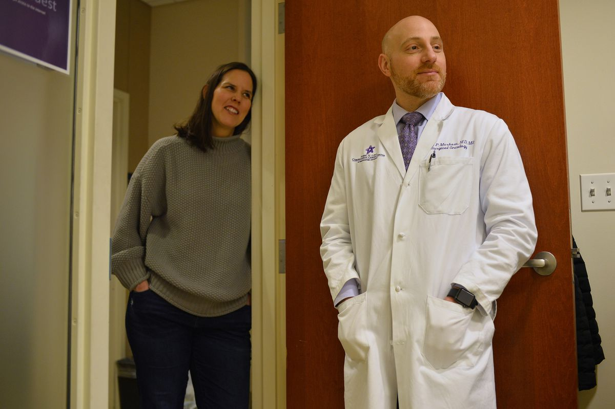 Dr. Ryan Merkow (right), a surgical oncologist at Northwestern Memorial Hospital, and Shannon Harrity, whose husband Sean O'Reilly is receiving chemotherapy with a specialized hepatic artery infusion pump at the Robert H. Lurie Comprehensive Cancer Center.