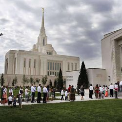 Visitors arrive for the Ogden Utah Temple open house, Friday, Aug. 22, 2014