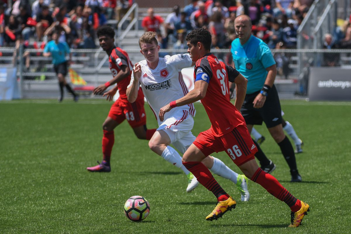 USL Photo - TFC II's Brian James on the ball in midfield in the May 24 meeting against the Richmond Kickers