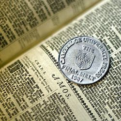 A medallion forged from type slugs of Cambridge Press was given to Wm. James Mortimer after his work on the LDS edition of the Bible.