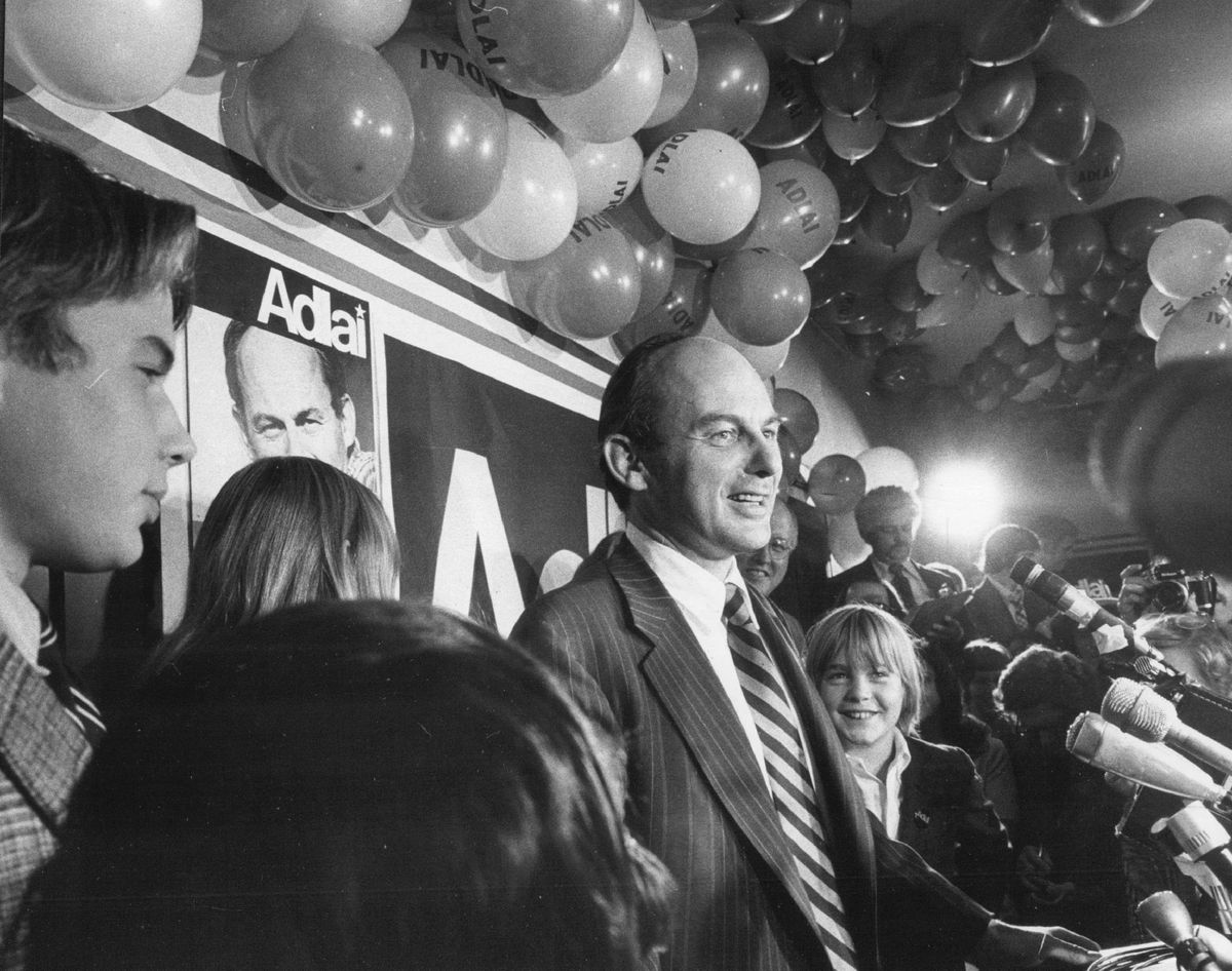 Sharing platform with his children, U.S. Sen Adlai E. Stevenson III celebrates a reelection victory in 1974.