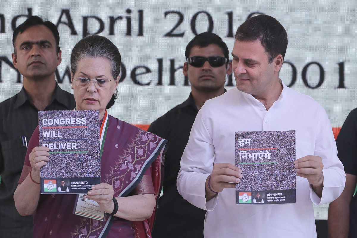 United Progressive Alliance Chairperson Sonia Gandhi, left, and Congress Party President Rahul Gandhi, right, release Congress party's manifesto for the upcoming general elections, in New Delhi, India, Tuesday, April 2, 2019. India's general elections are