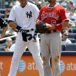 New York Yankees' Derek Jeter, left, talks with Los Angeles Angels first baseman Albert Pujols after Jeter singled during the first inning of a baseball game Saturday, April 14, 2012 at Yankee Stadium in New York.