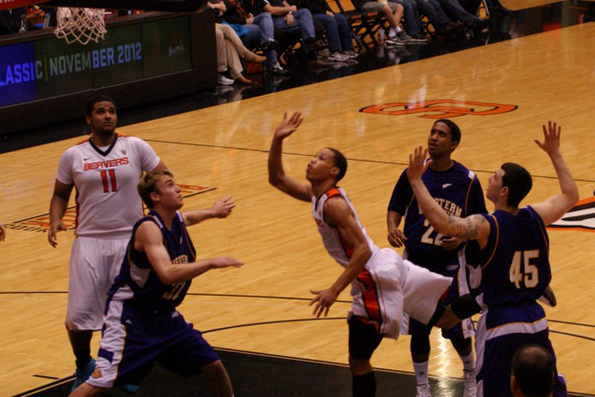 Even triple teaming didn't stop Jared Cunningham, who had 18 of his game high 22 points in the first half, when Oregon St. needed them. <em>(Photo by Andy Wooldridge)</em>