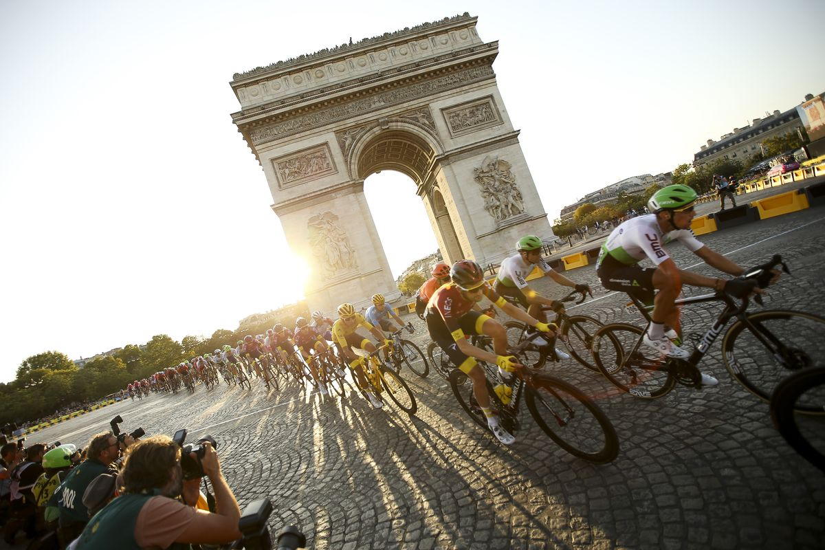 Yellow jersey Egan Bernal Gomez of Colombia and Team Ineos passes with the pack in front of Arc de Triomphe at the top of Avenue des Champs Elysees during stage 21 of the 106th Tour de France 2019, the last stage from Rambouillet to Paris - Champs Elysees (128km) on July 28, 2019 in Paris, France.