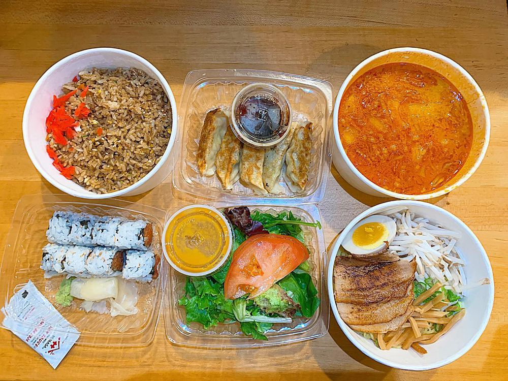 A takeout serving at Umai Ramen, featuring separate portions of soup and ramen for guests to combine at home,