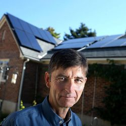 Jim French, who installed his first set of solar panels five years ago and recently added more panels, poses for a photograph at his home in Salt Lake City on Thursday, Aug. 28, 2014.