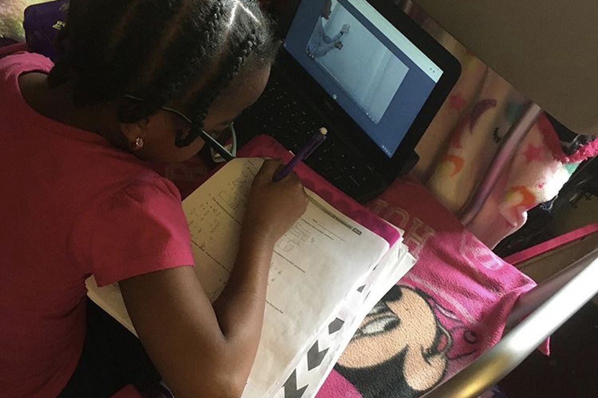 An East Harlem Academies student participates in remote learning. The charter network on Thursday announced classes would remain online for the rest of the school year.