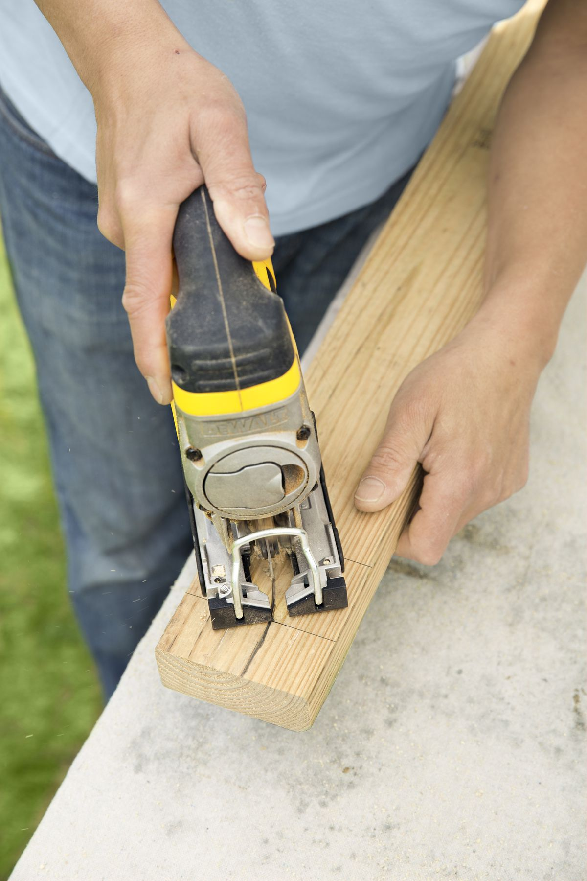 Man Cutting Tails Of Rafter For Garage Door Pergola