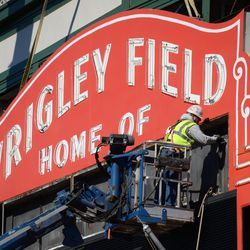 12:36 p.m. Worker possibly dismantling bolts on the back of the marquee -