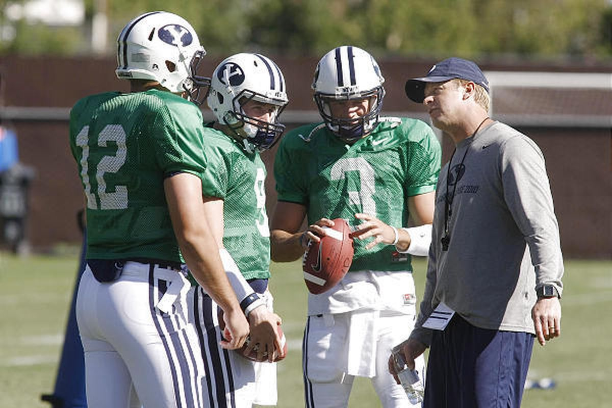 BYU head football coach Bronco Mendenhall talks with quarterbacks at practice. Rumors are swirling that the football team may seek independent status in football and join the WAC for the rest of its sports.