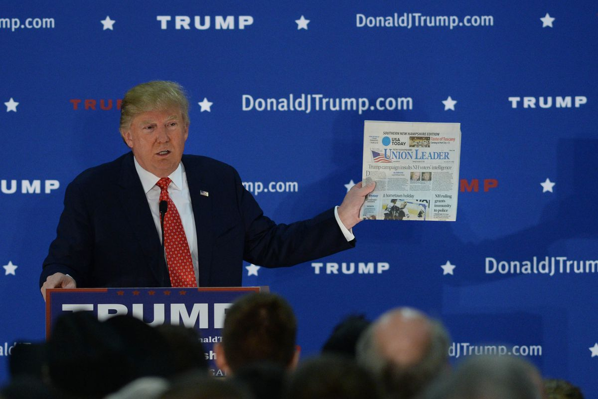 Trump holding copy of New Hampshire Union Leader