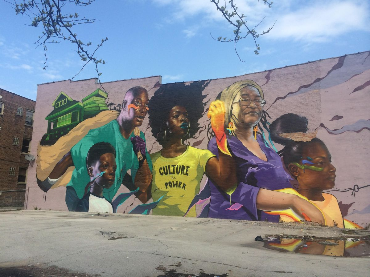 """""""Culture is Power,"""" one of Max Sansing's largest murals, focuses on family."""